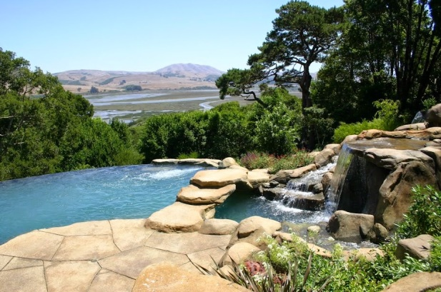 One of our favorite pools for a favorite client. This baby has everything, views, vanishing edge, waterfalls, spa, dive rock, swim jets, bridge, rock decking, cave, grotto and an equipment rock!