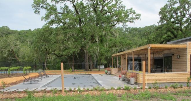 Glen Ellen covered pol, black pebble tec pool plaster and concrete decking.