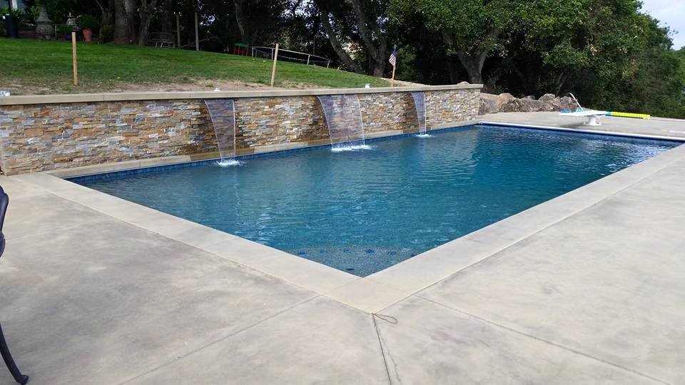This is a Petaluma covered pool that Aaron just built, it has a nice raised wall with water features, a pebble finish and decking.