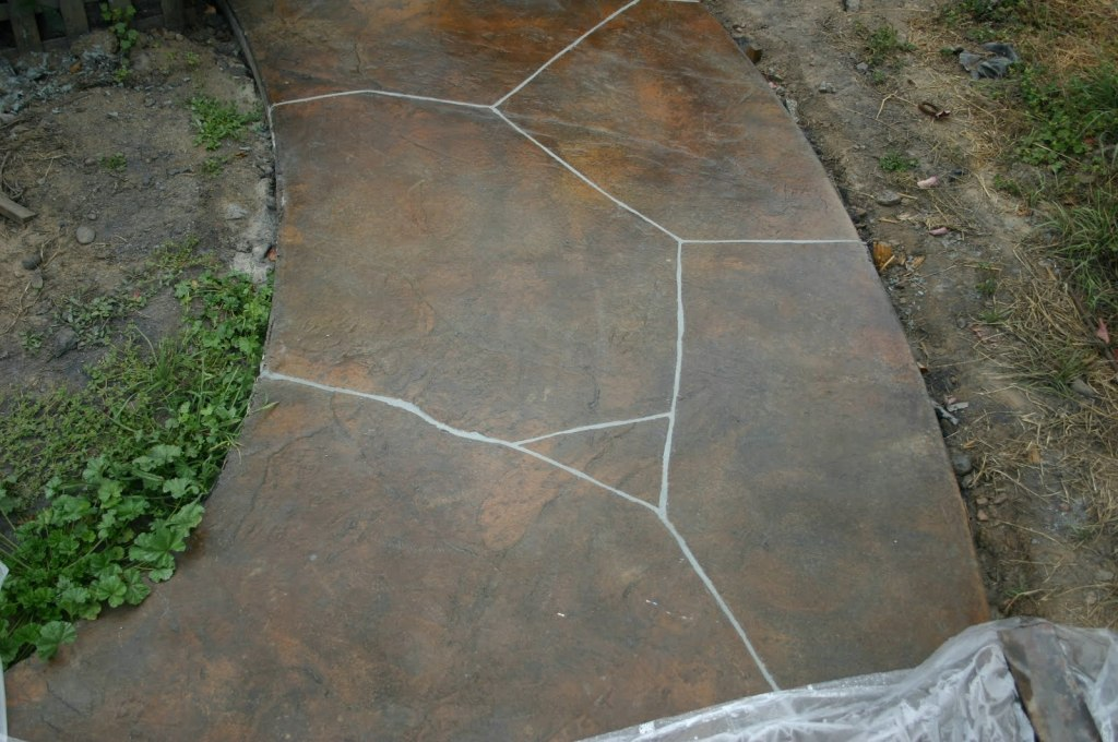 Terra Cotta stamped flag stone with grout.